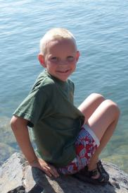 Nathan on the shore of Holter Lake